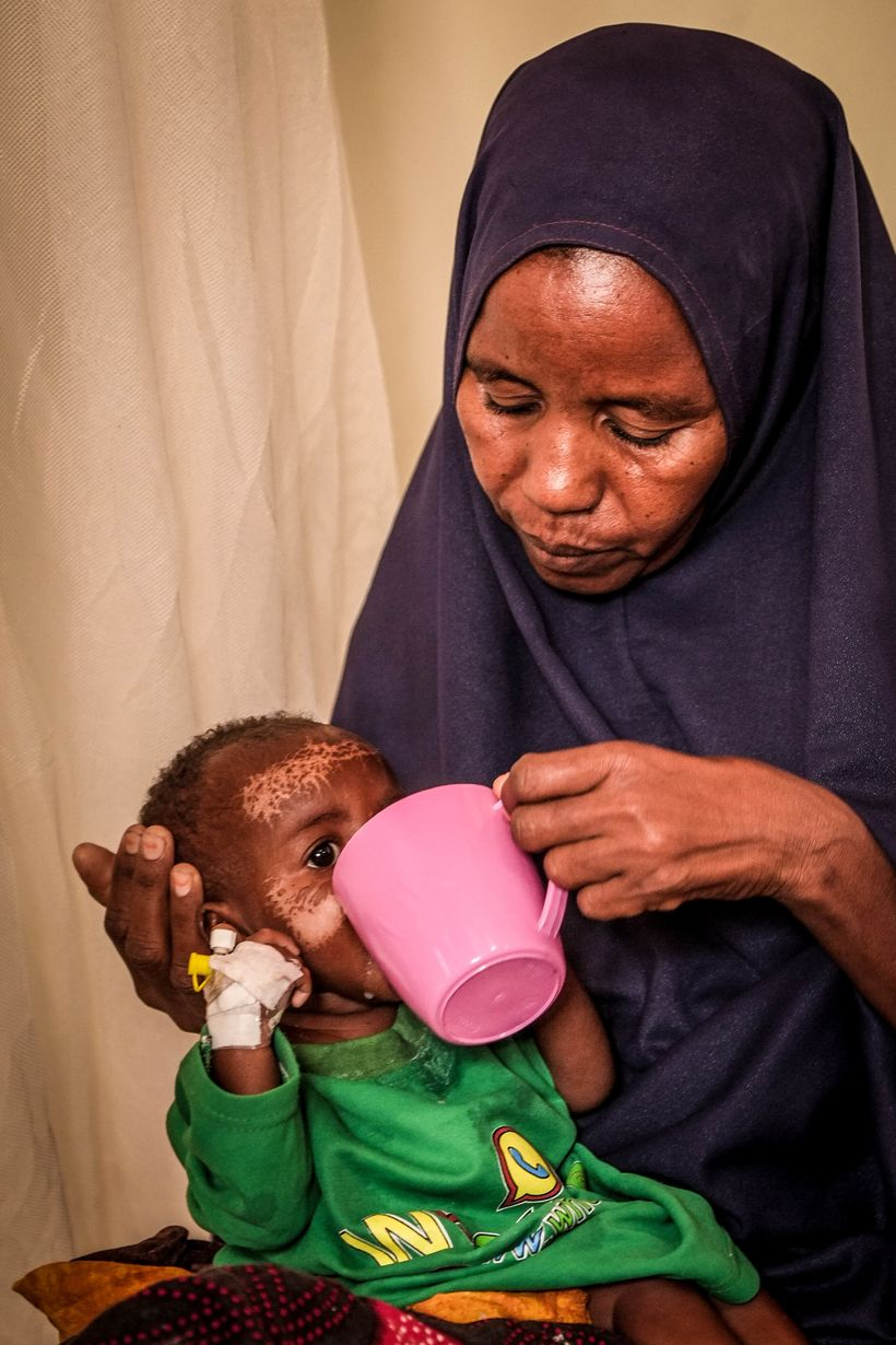 7-month-old Samira being fed by her mother