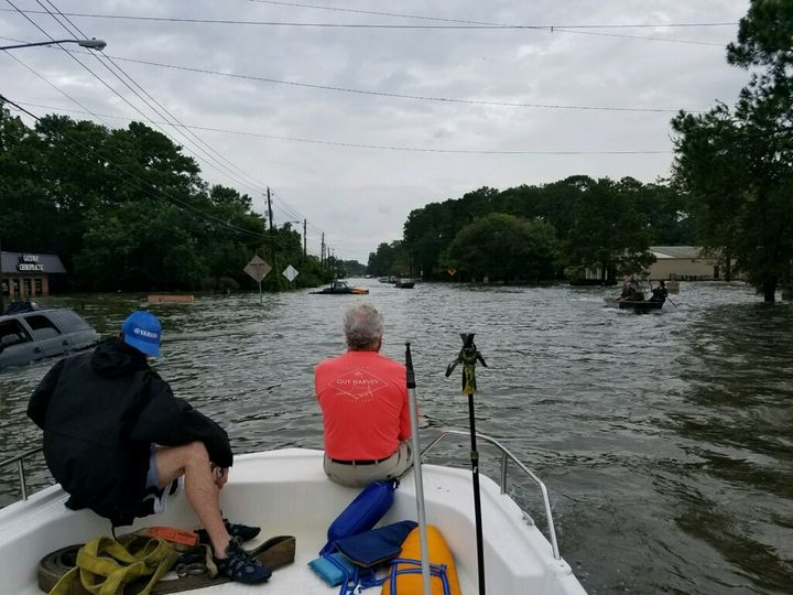 Kenneth Yates and Robert Young on Yates' Bay Stealth boat in Dickinson, Texas, on Aug. 27 as they set out to rescue people.