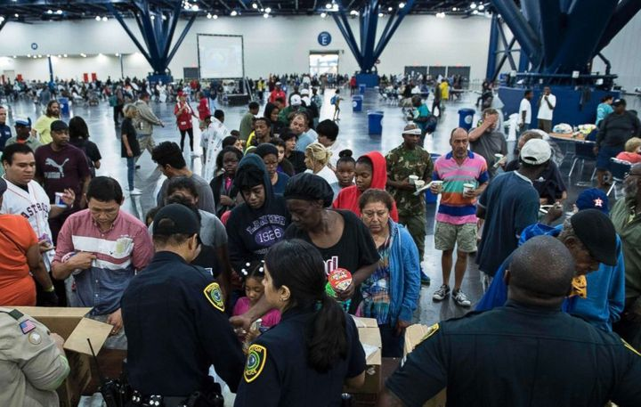 Hurricane Harvey flood victims gather at a shelter. (Source: Brendan Smialowski/AFP/Getty Images)