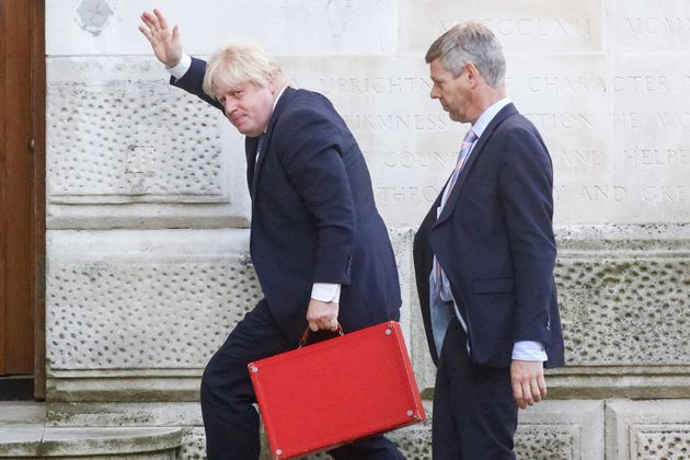 Foreign Secretary Boris Johnson with his red