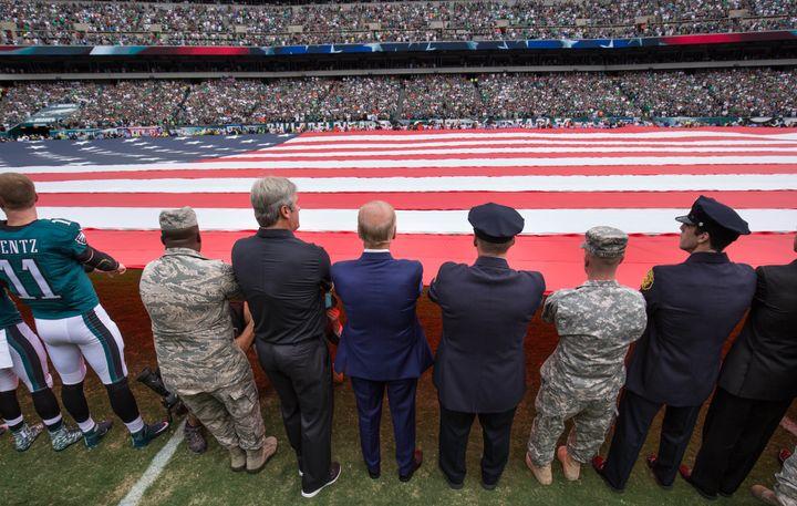 Vice President Joe Biden (blue suit),Philadelphia Eagles head coach Doug Pederson (left), and members of the military a