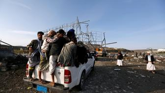 People ride on the back of a truck near a checkpoint of the armed Houthi movement hit by a Saudi-led airstrike near Sanaa, Yemen August 30, 2017. REUTERS/Khaled Abdullah