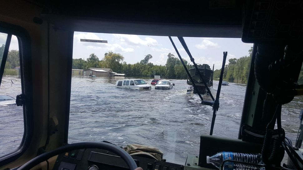 Floodwaters overtake vehicles in southeast Texas.