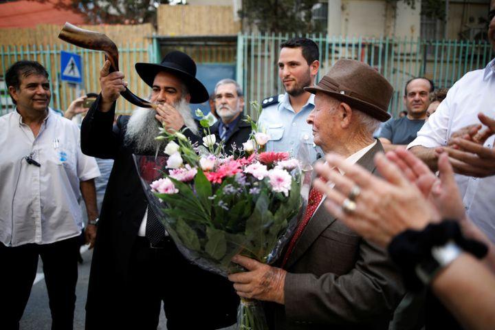 Shtamberg listens as a rabbi blows the Shofar, as part of celebrations marking his bar mitzvah ceremony.