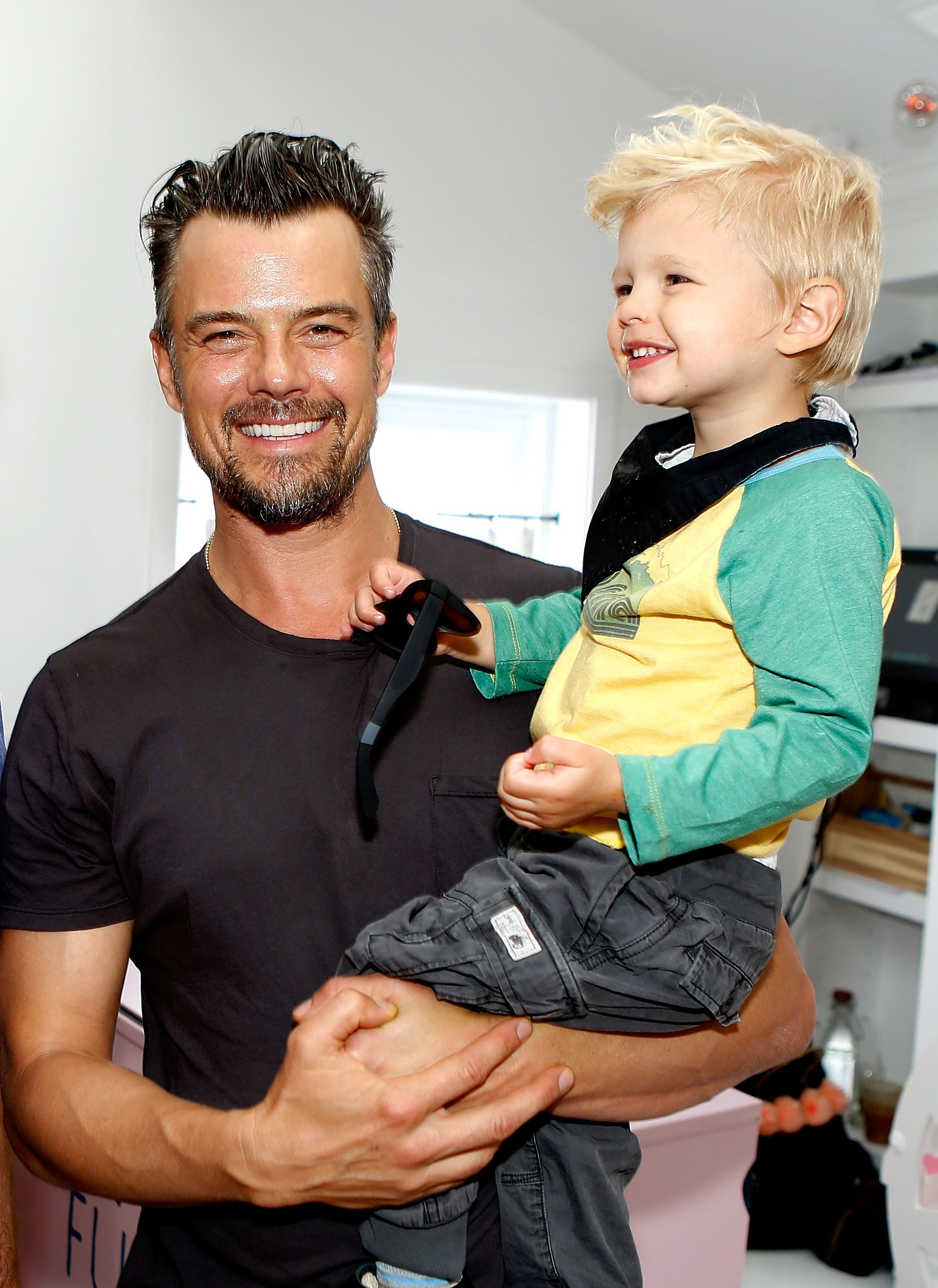 WEST HOLLYWOOD, California - MARCH 24: Josh Duhamel and son Axl attend the partnership celebration between TOMS and Oceana to help save the sea turtles on March 24, 2016 at Au Fudge in West Hollywood, California.  (Photo by Randy Shropshire/Getty Images for Oceana)