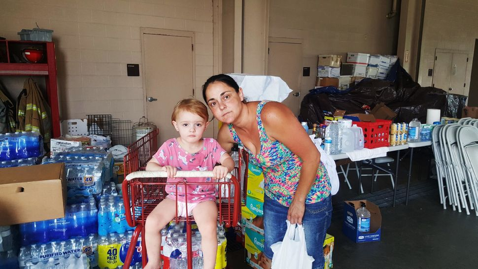 Beth Dougherty and her 2-year-old daughter, Natalee, are staying at the Orange County Emergency Services building in Orange,