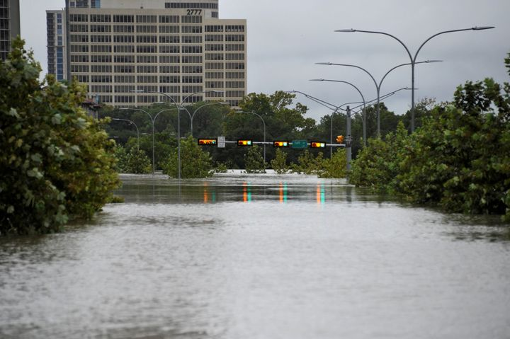 A downtown street is submerged in water in Houston, Texas during Hurricane Harvey.