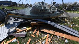 A damaged submarine lies amongst rubble after Hurricane Harvey caused widespread destruction in Rockport, Texas on September 1, 2017. / AFP PHOTO / MARK RALSTON        (Photo credit should read MARK RALSTON/AFP/Getty Images)