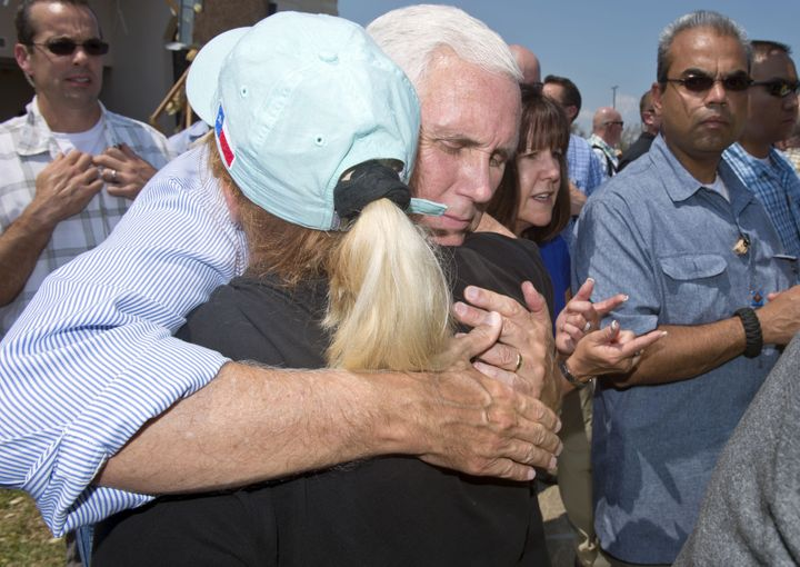 Vice President Mike Pence hugs a woman during a trip to survey the damage from Hurricane Harvey in Rockport, Texas, on Aug. 3