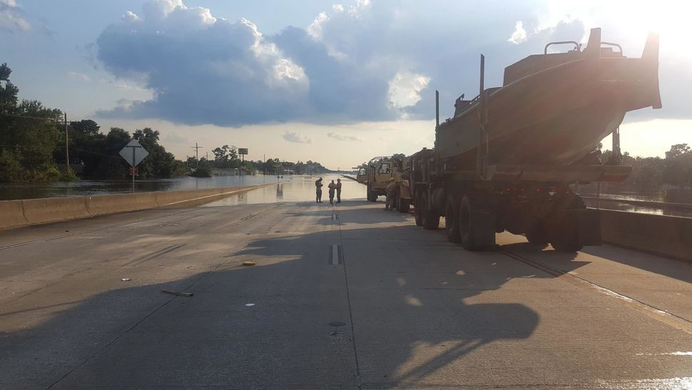 National Guard vehicles stop on Route 10 in Rose City.