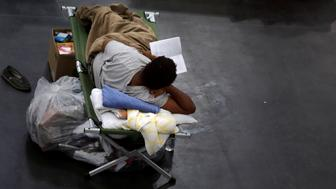 An evacuee affected by Tropical Storm Harvey takes shelter at the George R. Brown Convention Center in downtown Houston, Texas, U.S.  August 31, 2017. REUTERS/Carlos Barria