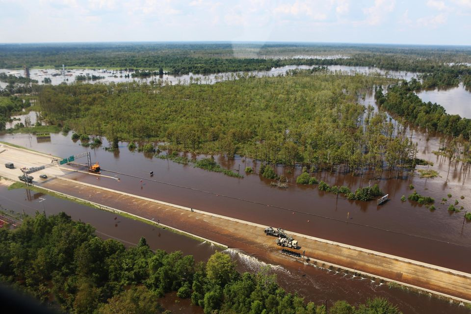 Highway I-10, a major connecting interstate, is underwater near Beaumont,