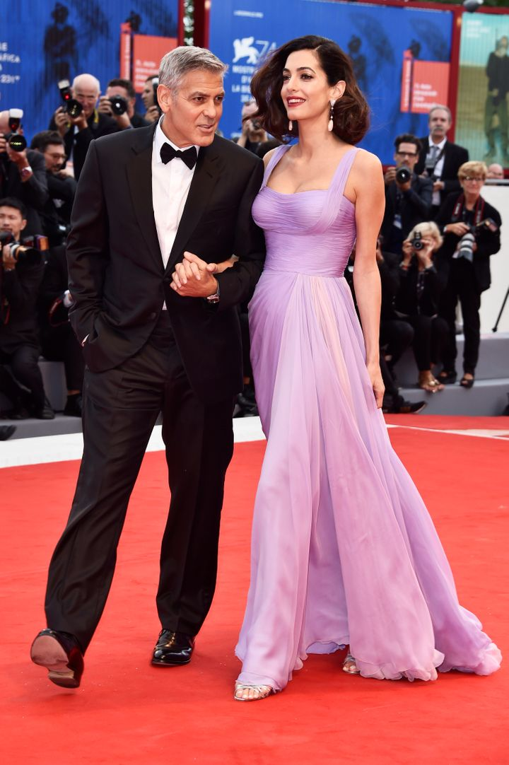 George Clooney and Amal Clooney walk the red carpet ahead of the 'Suburbicon' screening during the 74th Venice Film Festival.
