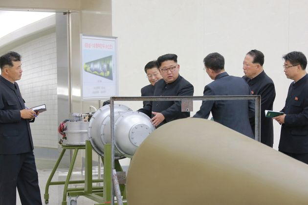 North Korean leader Kim Jong Un appears to provid guidance on a nuclear weapons programme in this undated...