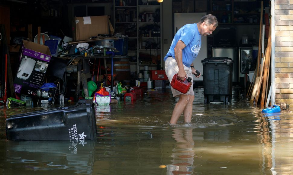 Pete Schroeter surveys his flooded garage on Aug. 31 for the first time after his house was flooded.