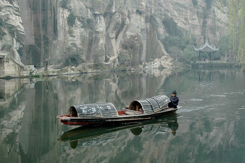 <em>Traditional boats powered by oars pushed by feet, at East Lake, a preserved village in Zhejiang</em>