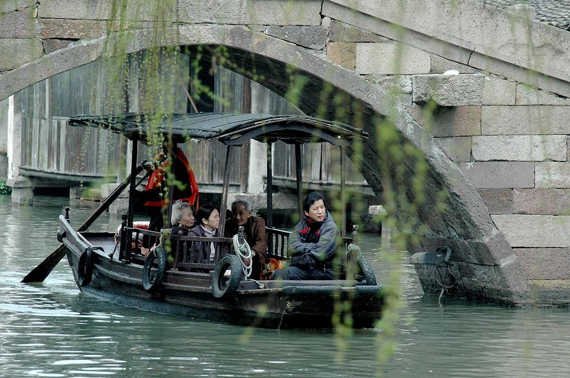 <em>A popular way to experience the magnificent scenery of Wuzhen and its bridges is by boat</em>