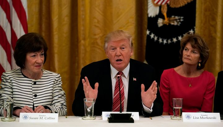 Murkowski, along with Sen. Susan Collins of Maine, sitting next to President Donald Trump in a June White House meeting where