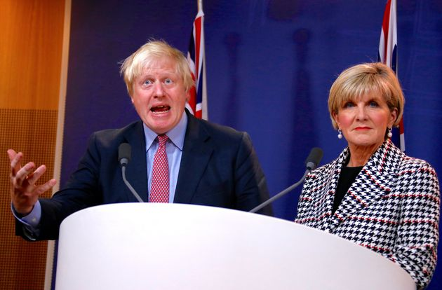 Johnson talks with Australian Foreign Minister Julie Bishop during a media conference in Sydney, Australia,...