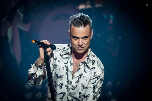 Robbie Williams has spoken about the dark side of
