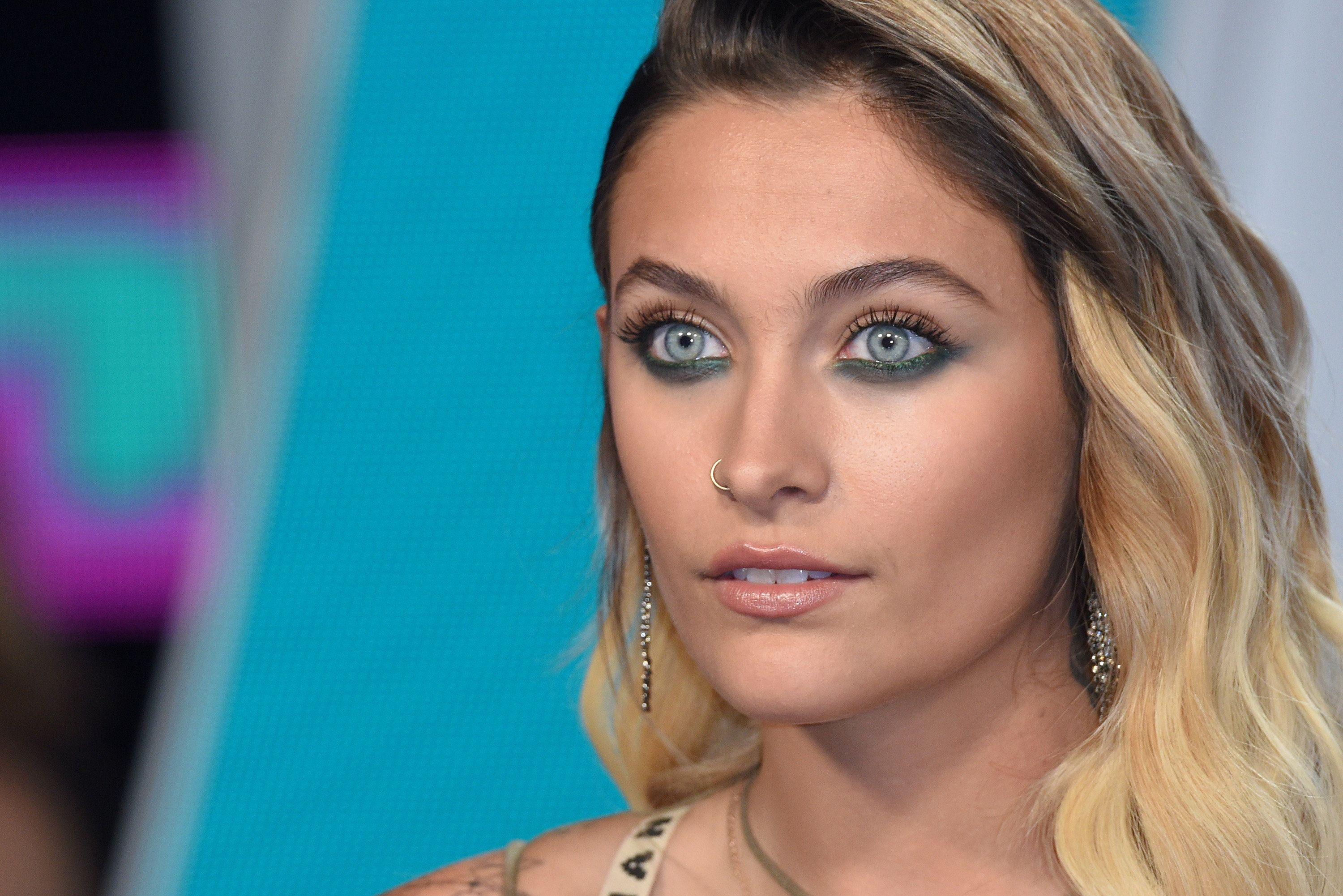 Paris Jackson bares all to show off her new chest tattoo