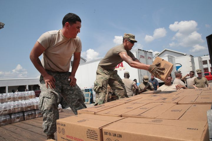 Members of the Texas Army National Guard from El Paso, Texas distribute food and water to flood victims in Orange, Texas,