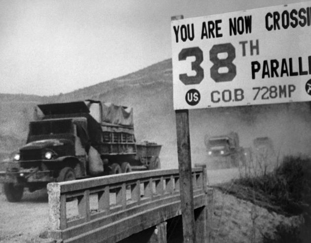 United Nations forces cross the 38th parallel while withdrawing from Pyongyang, the North Korean capital,