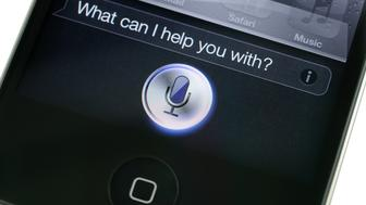 'Hong Kong, China - November 11, 2011: Apple iPhone 4s Siri. Siri is an intelligent personal assistant which works as an application for Apple's iOS.'