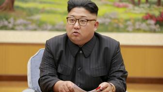 FILE PHOTO: North Korean leader Kim Jong Un participates in a meeting with the Presidium of the Political Bureau of the Central Committee of the WorkersÕ Party of Korea in this undated photo released by North Korea's Korean Central News Agency (KCNA) in Pyongyang September 4, 2017. KCNA via REUTERS/File Photo ATTENTION EDITORS - THIS PICTURE WAS PROVIDED BY A THIRD PARTY. REUTERS IS UNABLE TO INDEPENDENTLY VERIFY THE AUTHENTICITY, CONTENT, LOCATION OR DATE OF THIS IMAGE. NO THIRD PARTY SALES. NOT FOR USE BY REUTERS THIRD PARTY DISTRIBUTORS. SOUTH KOREA OUT. NO COMMERCIAL OR EDITORIAL SALES IN SOUTH KOREA. THIS PICTURE IS DISTRIBUTED EXACTLY AS RECEIVED BY REUTERS, AS A SERVICE TO CLIENTS.