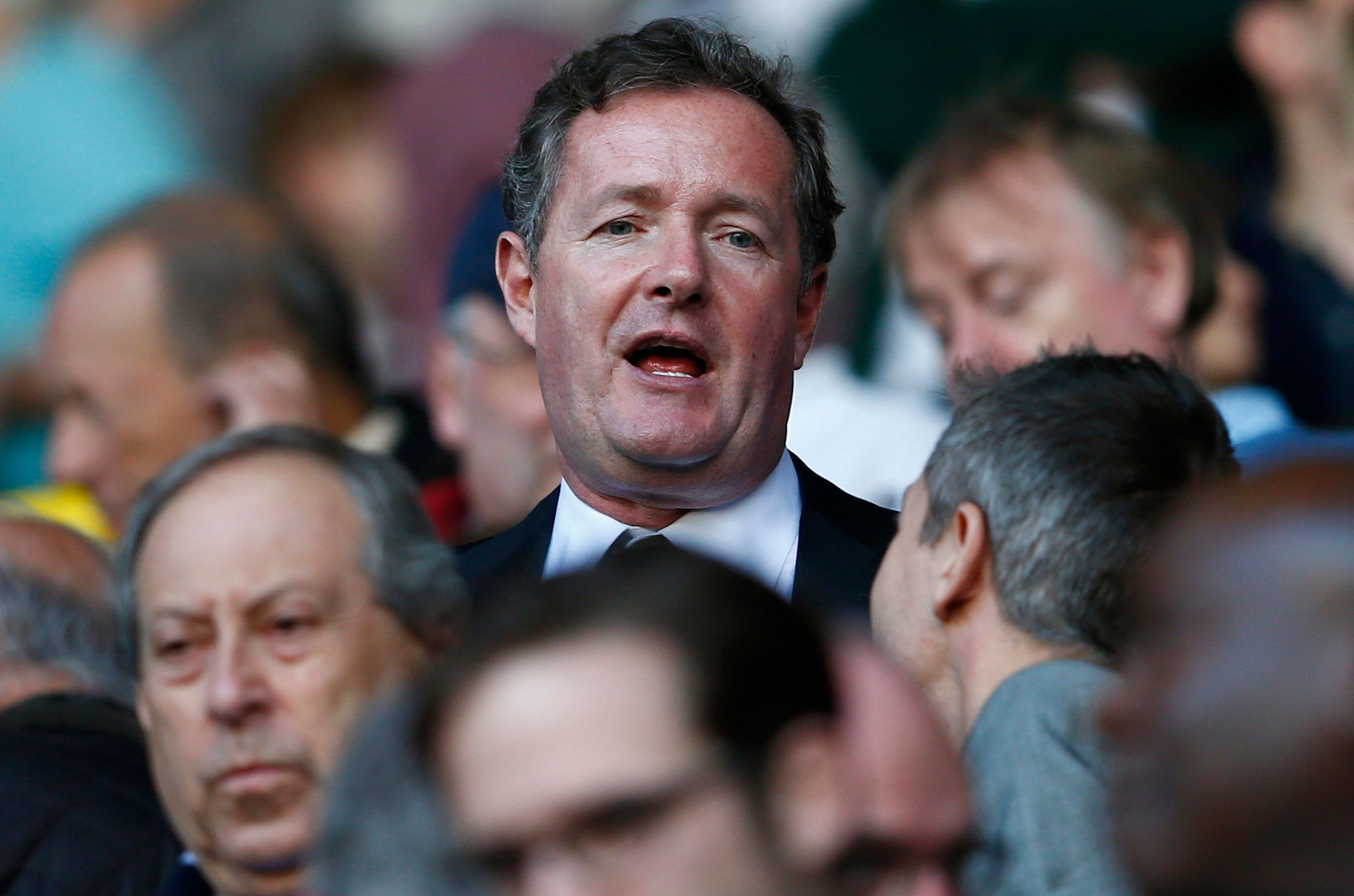 "Former newspaper editor Piers Morgan takes his seat in the stand before Arsenal play Tottenham Hotspur in their English Premier League soccer match at White Hart Lane in London, March 16, 2014. REUTERS/Eddie Keogh (BRITAIN - Tags: SPORT SOCCER MEDIA) FOR EDITORIAL USE ONLY. NOT FOR SALE FOR MARKETING OR ADVERTISING CAMPAIGNS. NO USE WITH UNAUTHORIZED AUDIO, VIDEO, DATA, FIXTURE LISTS, CLUB/LEAGUE LOGOS OR ""LIVE"" SERVICES. ONLINE IN-MATCH USE LIMITED TO 45 IMAGES, NO VIDEO EMULATION. NO USE IN BETTING, GAMES OR SINGLE CLUB/LEAGUE/PLAYER PUBLICATIONS"