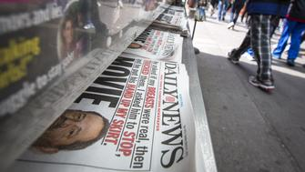 Copies of the New York Daily News are displayed on a newsstand in New York's Times Square March 31, 2015.  U.S. cable T.V. operator Cablevision Systems Corp is planning to make an offer for the New York Daily News as early as this week, valuing the troubled tabloid at just $1, according to a person familiar with the matter.  REUTERS/Brendan McDermid