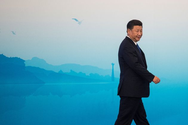 Chinese President Xi Jinping arrives to hold a press conference at the BRICS Summit in Xiamen, Fujian...