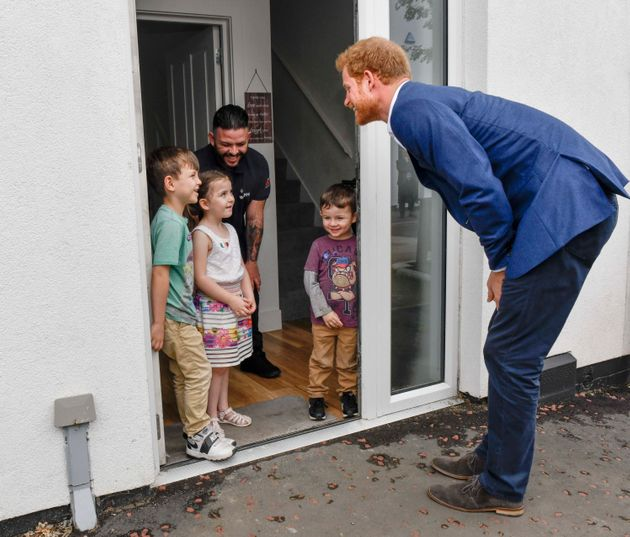 Prince Harry meets 5 year old Lily Anne Flores and her brothers Kobbi and Damaso and her father Simon...