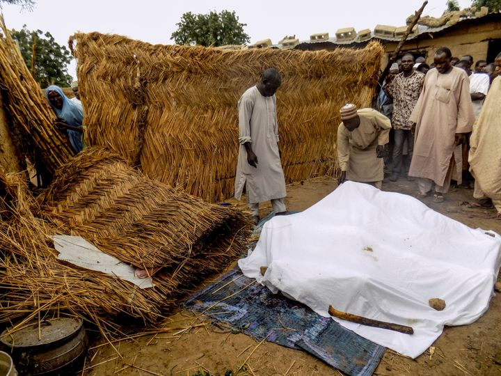 The victims of a Boko Haram suicide bombing in northeast Nigera are covered with a white sheet. File photo from June att