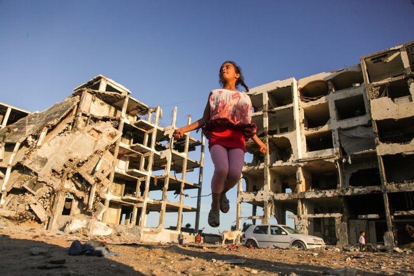 Girl playing in the Gaza rubble