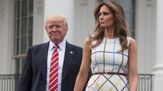 US President Donald Trump and First Lady Melania Trump arrive at the Congressional picnic at the White House in Washington, DC, on June 22, 2017. / AFP PHOTO / NICHOLAS KAMM        (Photo credit should read NICHOLAS KAMM/AFP/Getty Images)