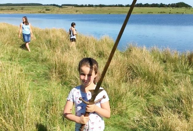 The 7-year-old was swimming around the lake last week when she spotted the sword on the
