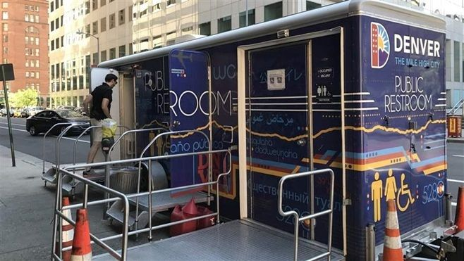 A man enters a mobile restroom in downtown Denver. City officials hope the bathrooms will make the urban core cleaner and mor