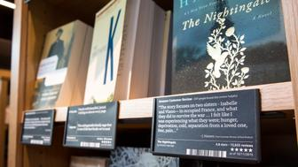 SEATTLE, WA - NOVEMBER 4: Snippets from online Amazon customer reviews as well as star ratings are displayed for all the books at the Amazon Books store on November 4, 2015 in Seattle, Washington. The online retailer opened its first brick-and-mortar book store on November 3, 2015. (Photo by Stephen Brashear/Getty Images)