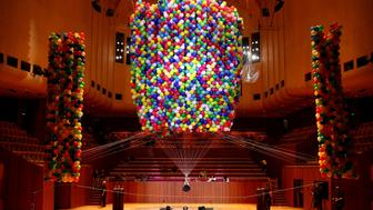 SYDNEY, AUSTRALIA - SEPTEMBER 03:     Austrian British artist Nomi Lakmaier is bound,immobilised and lifted by 20,000 multi-coloured party balloons during a nine hour performance on the stage of the Concert Hall at the Sydney Opera House on September 3, 2017 in Sydney, Australia. The artwork titled 'Cherophobia' explores notions of desire, restraint and control. It has been staged only once before in London as part of the Unlimited Festival.  (Photo by Cameron Spencer/Getty Images)