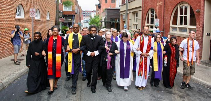 Dr. Cornel West walking with group of clergy on a march to downtown Charlottesville, where they knelt in prayer on the south