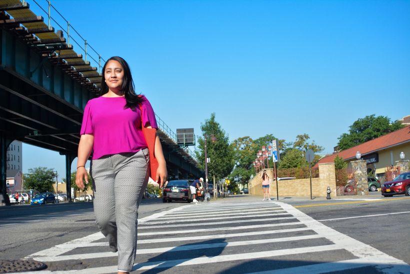 Amanda Farias walking the streets of her neighborhood