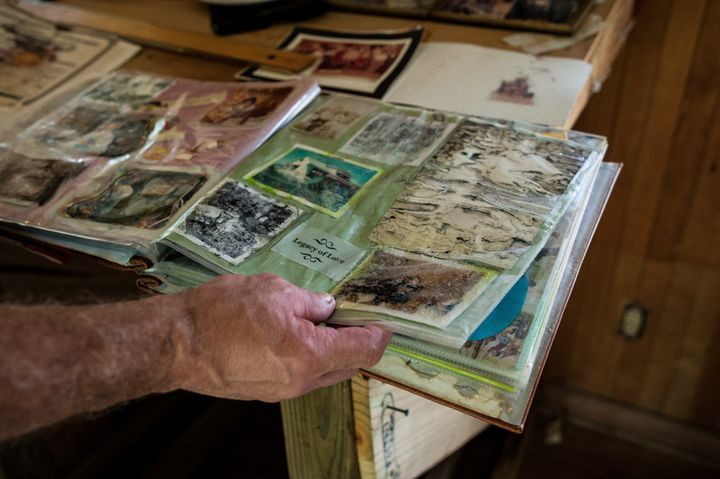 Gary Puett looks through a childhood photo album that was damaged in the flooding from Harvey.