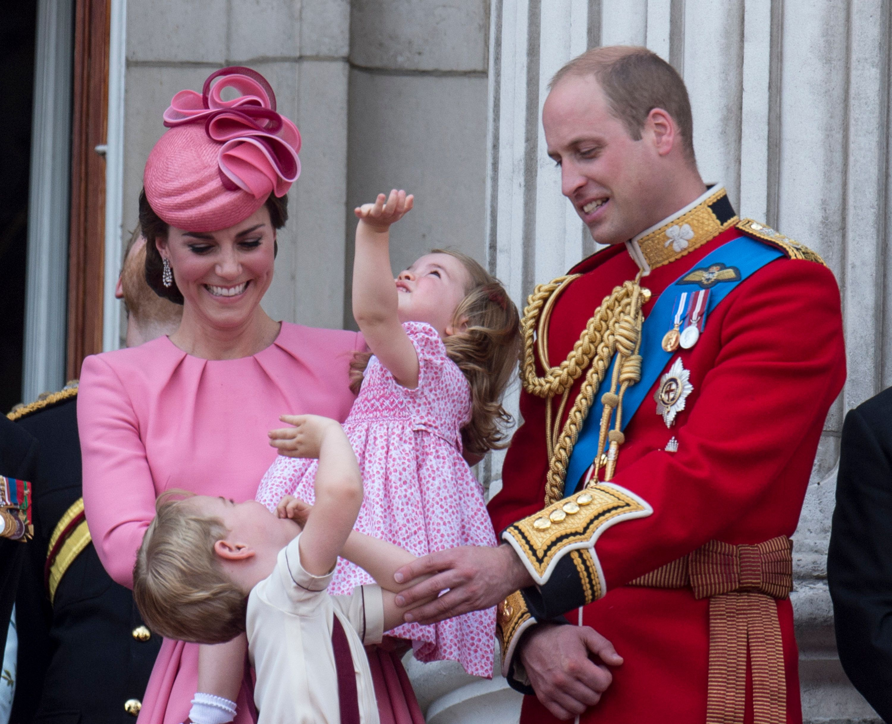 LONDON, ENGLAND - JUNE 17:  Prince William, Duke of Cambridge and Catherine, Duchess of Cambridge with Prince George of Cambridge and Princess Charlotte of Cambridge on the balcony at Buckingham Palace during the annual Trooping The Colour parade on June 17, 2017 in London, England.  (Photo by Mark Cuthbert/UK Press via Getty Images)