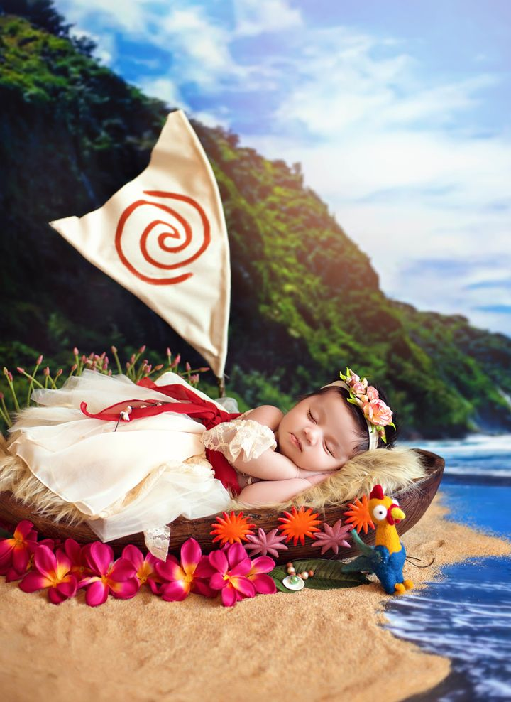 Baby Moana sleepily posed alongside the film's funny rooster character named Heihei.