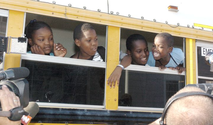 Children head off to their first day of school in Houston on Sept. 8, 2005, in the aftermath of Hurricane Katrina.