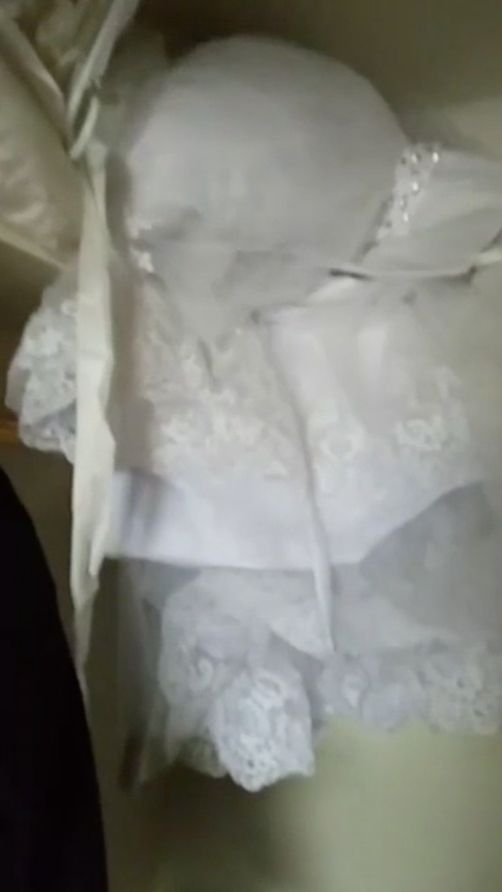 A screenshot from Parry's Facebook Live video, showing the wedding dress still dry inside the closet.