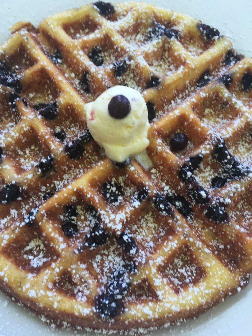 The blueberry cornbread waffles at Cafe 222 are delicious, transporting you to endless summer.