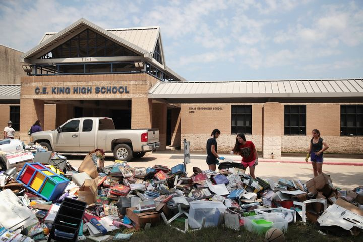 Volunteers and students from Houston's C.E. King High School help clean up the school in the aftermath of Tropical Storm