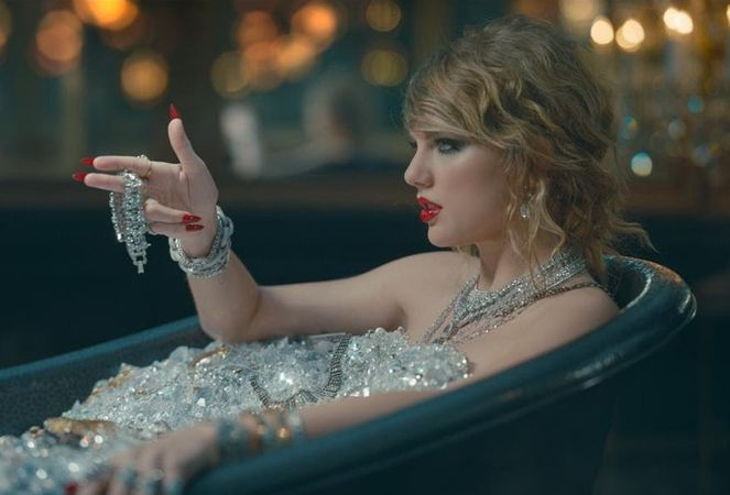 "Taylor Swift, sitting in a bathtub full of diamonds, in a still from her latest music video, ""Look What You Made Me Do""."